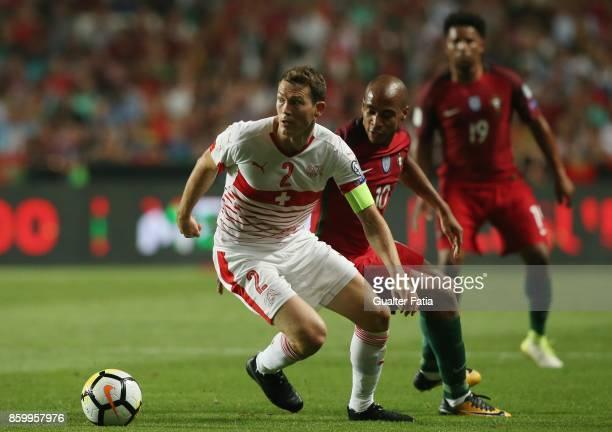 Switzerland defender Stephan Lichtsteiner with Switzerland midfielder Granit Xhaka in action during the FIFA 2018 World Cup Qualifier match between...