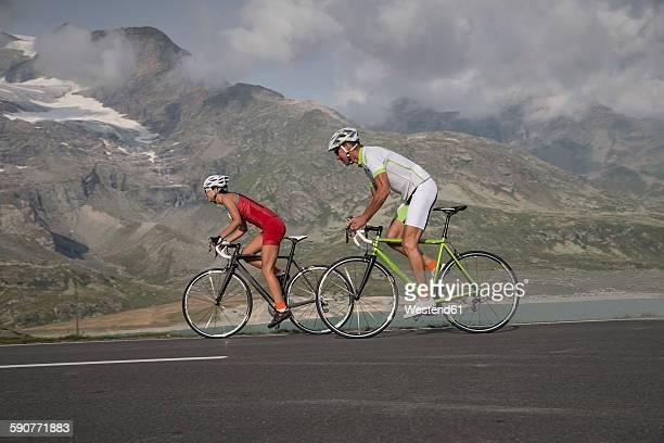 Switzerland, Engadin, two cyclists on Bernina Pass