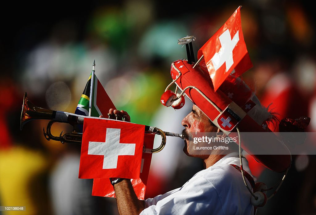A Switzerland fan plays a trumpet prior to the 2010 FIFA World Cup South Africa Group H match between Spain and Switzerland at Durban Stadium on June 16, 2010 in Durban, South Africa.