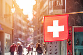 Switzerland flag and view of city center of Lucerne