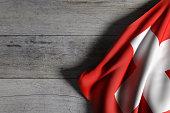 3d rendering of Switzerland flag waving on wooden background