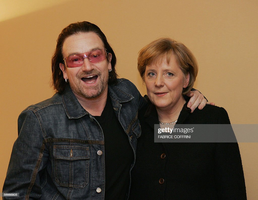 German Chancellor Angela Merkel smiles while meeting with British star <a gi-track='captionPersonalityLinkClicked' href=/galleries/search?phrase=Bono&family=editorial&specificpeople=167279 ng-click='$event.stopPropagation()'>Bono</a> at the World Economic Forum in Davos 25 January 2006. AFP PHOTO FABRICE COFFRINI
