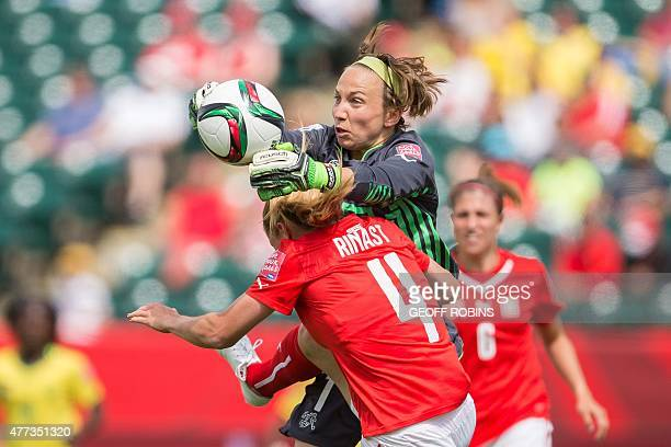 Switzerland goalkeeper Gaelle Thalmann collides with teammate Rachel Rinast during the first half of their FIFA Women's World Cup group C match...
