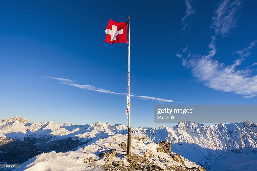 Switzerland, Graubuenden, Savognin, Mountaintop Piz Martegnas, swiss flag