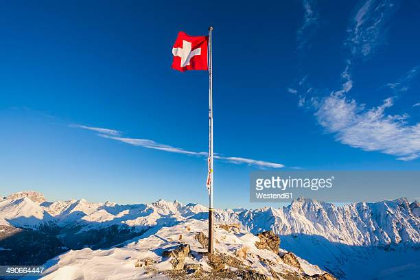 Switzerland, Graubuenden, Savognin, Mountaintop Piz Martegnas, swiss flag