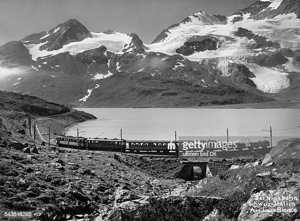 Upper Engadin Bernina Express of the Rhaetian Railway at the Lago Bianco with mountains in the background 1938 Photographer Steiner Vintage property...
