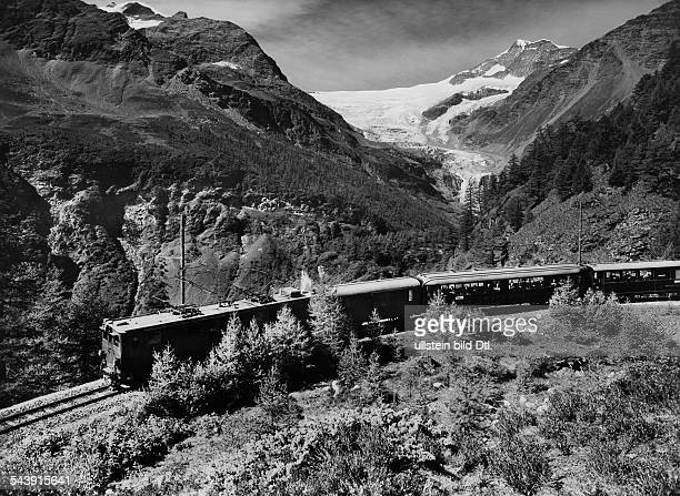 Upper Engadin The Bernina Express of the Rhaetian Railway near Alp Gruem View of the Piz Palue and the Palue Glacier 1954 Photographer Steiner...