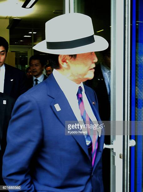 GENEVA Switzerland Japanese Deputy Prime Minister and Finance Minister Taro Aso arrives at Geneva airport on July 2 2013 Aso plans to attend a...