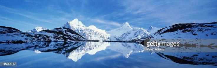 Switzerland, Jungfrau, Wetterhorn, snow-covered mountains and lake