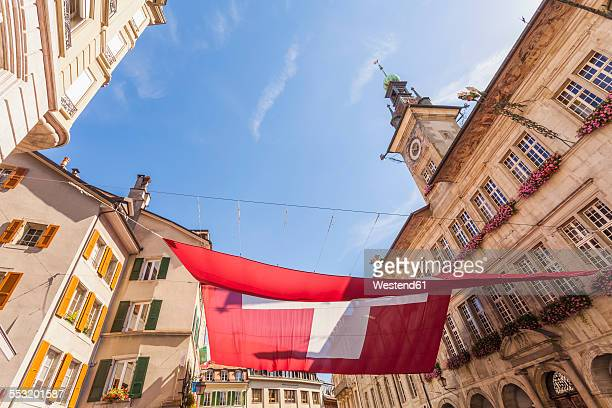 Switzerland, Lausanne, Swiss Flag and town hall