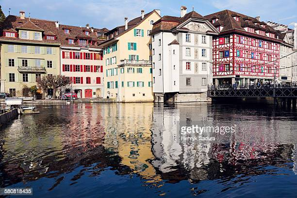 Switzerland, Lucerne, Townhouses reflecting in water