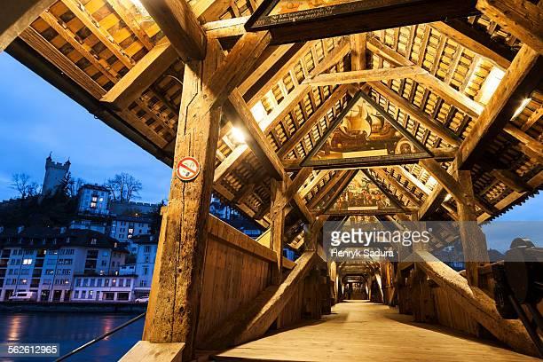 Switzerland, Lucerne, View along illuminated Spreuer Bridge