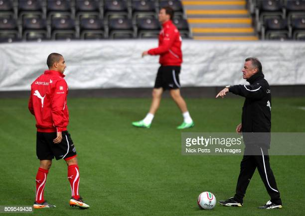Switzerland Manager Ottmar Hitzfeld talks with his captain Gokhan Inler during a training session at the Liberty Stadium Swansea