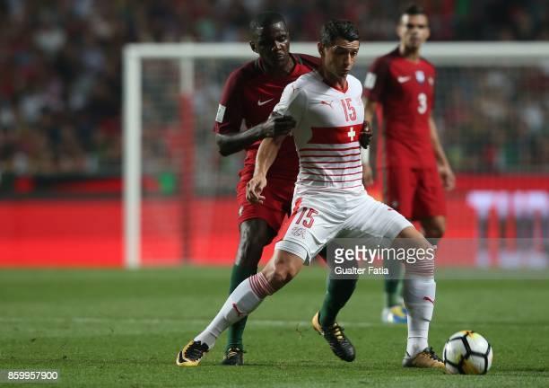 Switzerland midfielder Blerim Dzemaili with Portugal midfielder William Carvalho in action during the FIFA 2018 World Cup Qualifier match between...