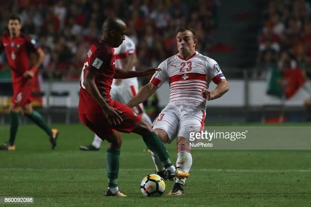 Switzerland midfielder Xherdan Shaqiri and Portugal midfielder Joao Mario during the match between Portugal v Switzerland FIFA 2018 World Cup...