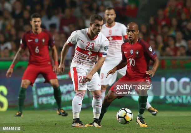 Switzerland midfielder Xherdan Shaqiri with Portugal midfielder Joao Mario in action during the FIFA 2018 World Cup Qualifier match between Portugal...