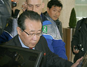 GENEVA Switzerland North Korean First Vice Foreign Minister Kim Kye Gwan heads for the second day of talks in Geneva on Oct 25 with Stephen Bosworth...