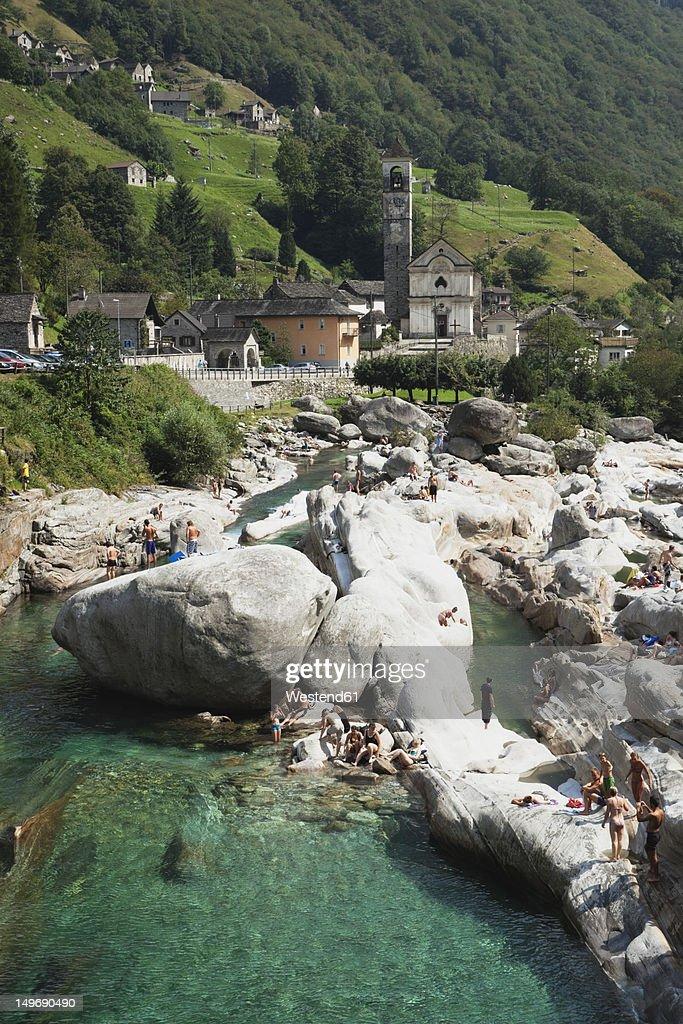 Switzerland, People bathing at Verzasca River