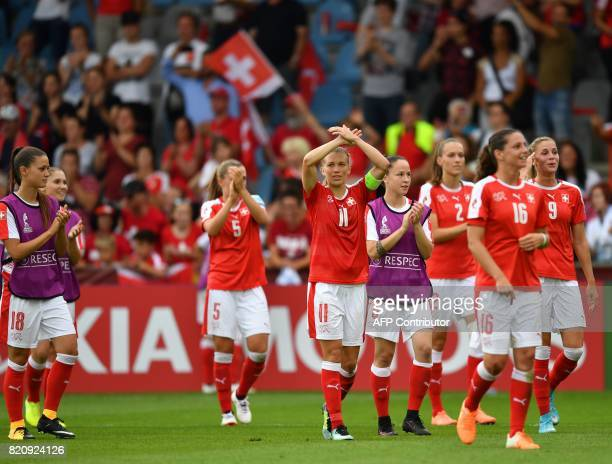 Switzerland players react after winning the UEFA Womens Euro 2017 football tournament match between Iceland and Switzerland at Stadion De Vijverberg...