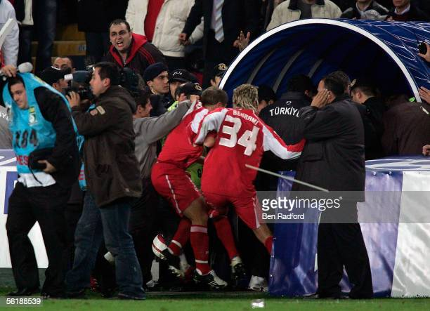 Switzerland players run to the safety of the dressing room as they are pelted with missiles after the FIFA World Cup Playoff 2nd Leg match between...
