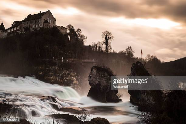 Switzerland, Schaffhausen, Rhine falls with Laufen Castle in the evening light