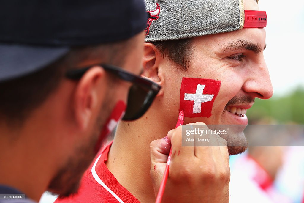 Switzerland supporters enjoy the atmosphere prior to the UEFA EURO 2016 round of 16 match between Switzerland and Poland at Stade Geoffroy-Guichard on June 25, 2016 in Saint-Etienne, France.