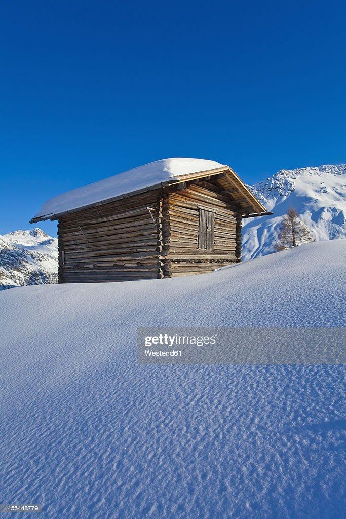 Switzerland, View of  hut in snow