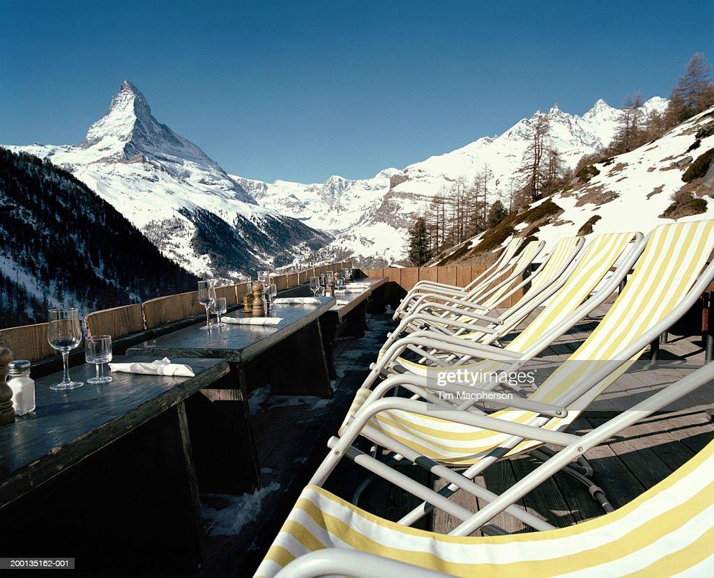 Switzerland, Zermatt, row of chairs on veranda over looking Matterhorn : Stock Photo