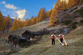 Switzerland, Zermatt, two alphorn players near Matterhorn