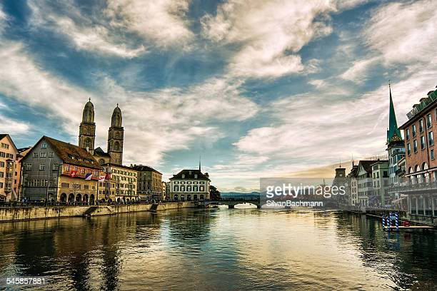 Switzerland, Zurich, Cloudy sky above town canal