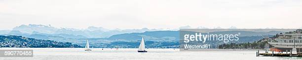 Switzerland, Zurich, Lake Zurich with boats in cloudy day, panorama
