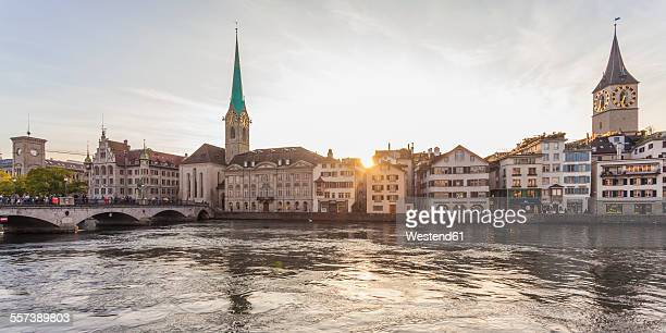 Switzerland, Zurich, River Limmat, Fraumuenster Church and St. Peter Church, Panorama in the evening