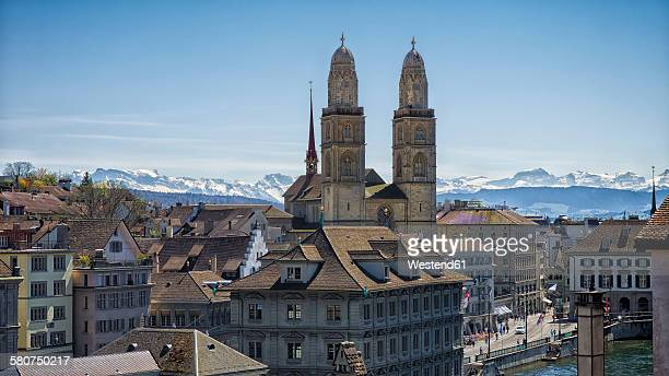 Switzerland, Zurich, View to Great Minster and Alps in the background
