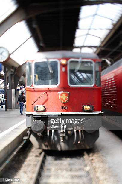 Switzerland ZurichKanton Zurich Electric locomotive 11 143 of the series Re 4 / 4 II in front of a Regional InterSBB in Zurich's main station