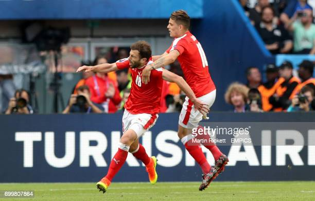Switzerland's Admir Mehmedi celebrates scoring his side's first goal of the game with teammate Granit Xhaka