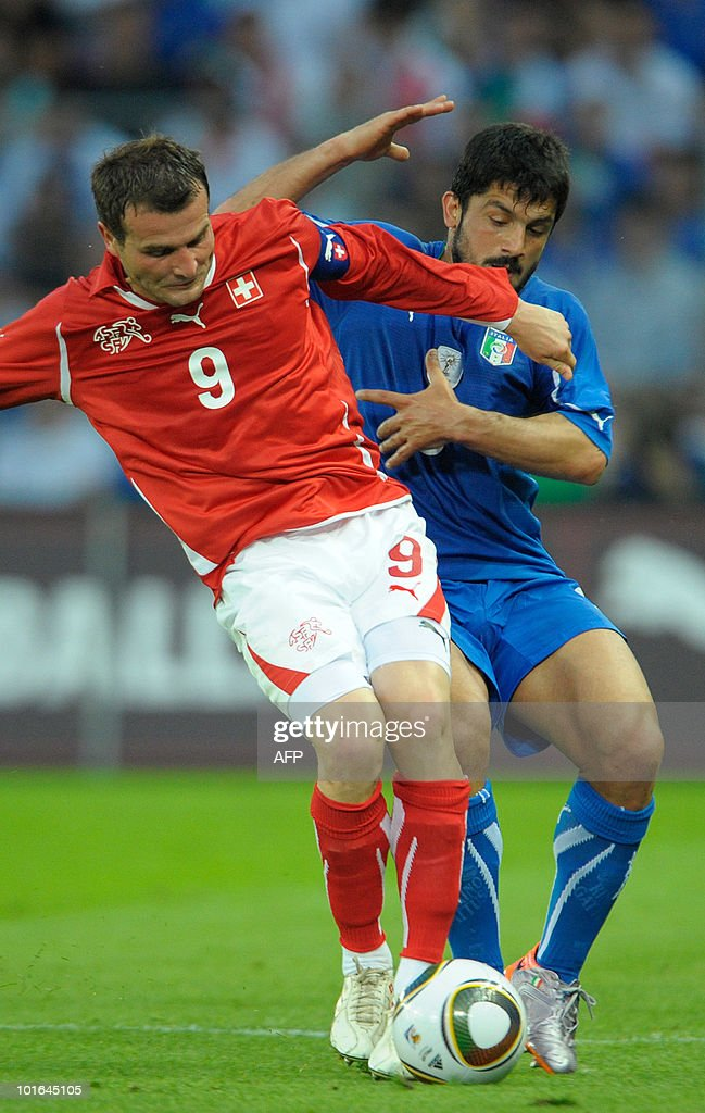 Switzerland's Alexander Frei (L) fights for the ball with the Italian Gennaro Gattuso (R) during their friendly game Switzerland vs Italy on June 5, at the La Praille stadium in Geneva.