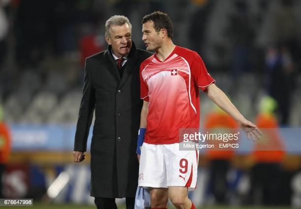 Switzerland's Alexander Frei talks to their Head Coach Ottmar Hitzfeld after the final whistle