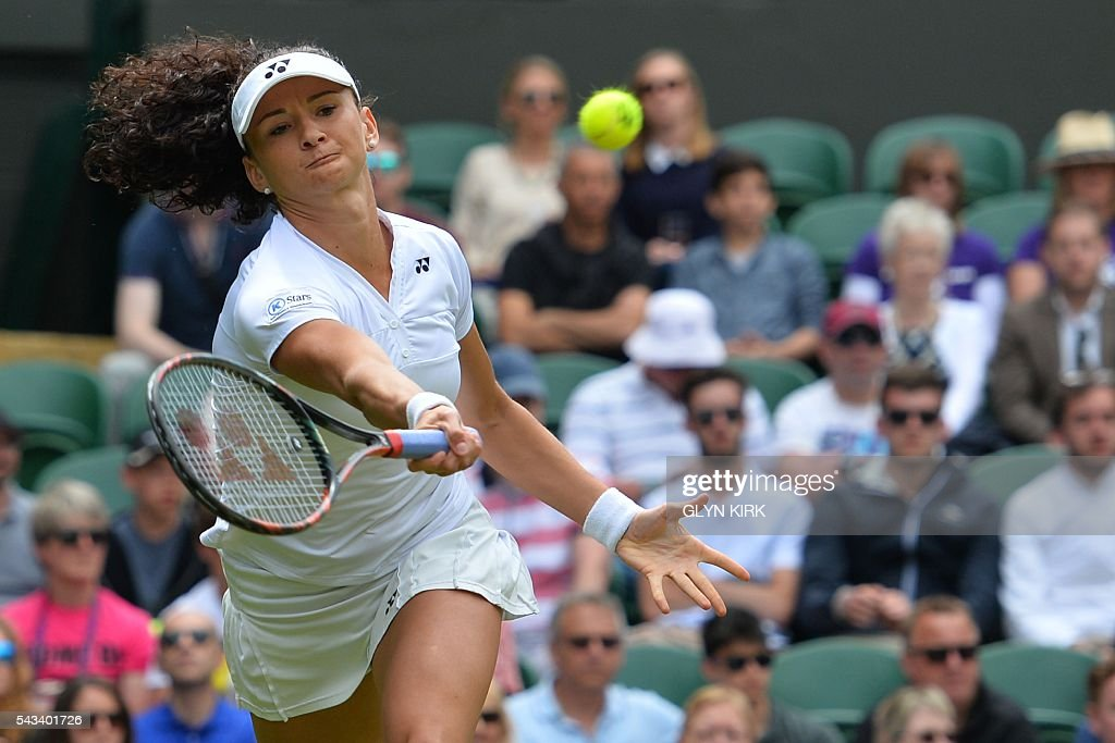 Switzerland's Amra Sadikovic returns against US player Serena Williams during their women's singles first round match on the second day of the 2016 Wimbledon Championships at The All England Lawn Tennis Club in Wimbledon, southwest London, on June 28, 2016. / AFP / GLYN