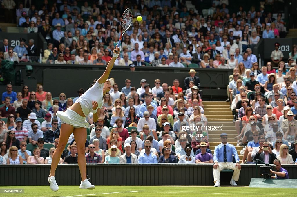 Switzerland's Amra Sadikovic serves against US player Serena Williams during their women's singles first round match on the second day of the 2016 Wimbledon Championships at The All England Lawn Tennis Club in Wimbledon, southwest London, on June 28, 2016. / AFP / GLYN