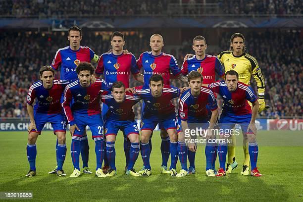 Switzerland's Basel players front row defender Kay Voser Egyptian midfielder Mohamed Salah midfielder Taulant Xhaka Sweden midfielder Behrang Safari...