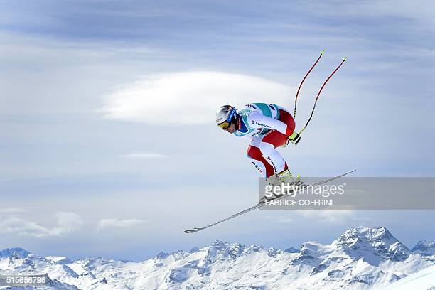 Switzerland's Beat Feuz jumps during the men's downhill practice at the FIS Alpine Skiing World Cup finals on March 15 2016 in St Moritz / AFP /...