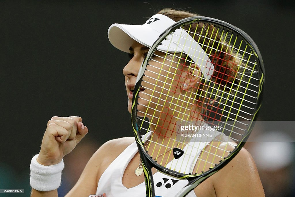 Switzerland's Belinda Bencic celebrates after winning the first set against Bulgaria's Tsvetana Pironkova during their women's singles single round match on the third day of the 2016 Wimbledon Championships at The All England Lawn Tennis Club in Wimbledon, southwest London, on June 29, 2016. / AFP / ADRIAN
