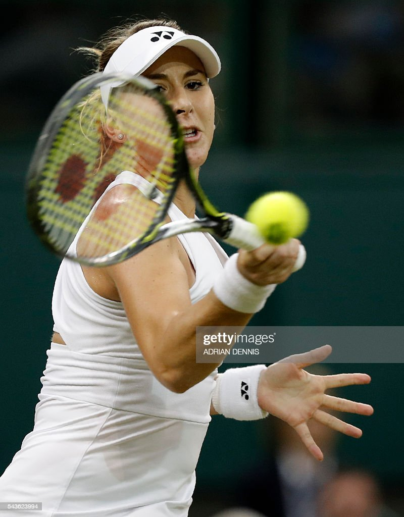 Switzerland's Belinda Bencic returns to Bulgaria's Tsvetana Pironkova during their women's singles single round match on the third day of the 2016 Wimbledon Championships at The All England Lawn Tennis Club in Wimbledon, southwest London, on June 29, 2016. / AFP / ADRIAN