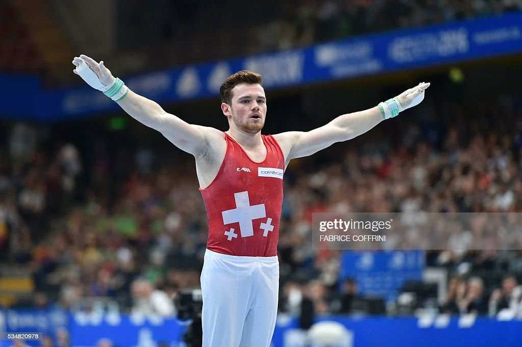 Switzerland's Benjamin Gischard competes in the Mens Rings competition of the European Artistic Gymnastics Championships 2016 in Bern, Switzerland on May 28, 2016. / AFP / FABRICE