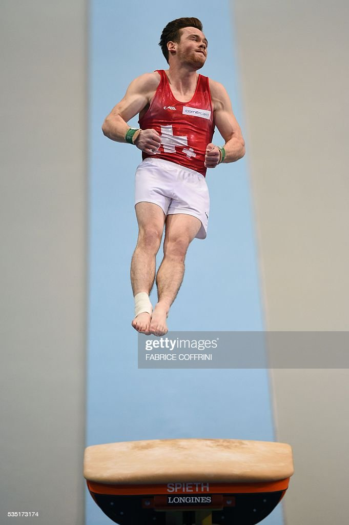 Switzerlands Benjamin Gischard performs during the Mens Vault competition of the European Artistic Gymnastics Championships 2016 in Bern, Switzerland on May 29, 2016. / AFP / FABRICE