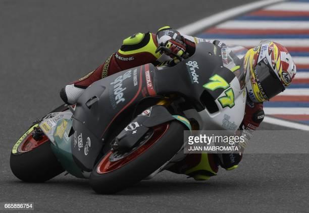 Switzerland's biker Dominique Aegerter rides his Suter during the Moto2 free practice of the Argentina Grand Prix at Termas de Rio Hondo circuit in...