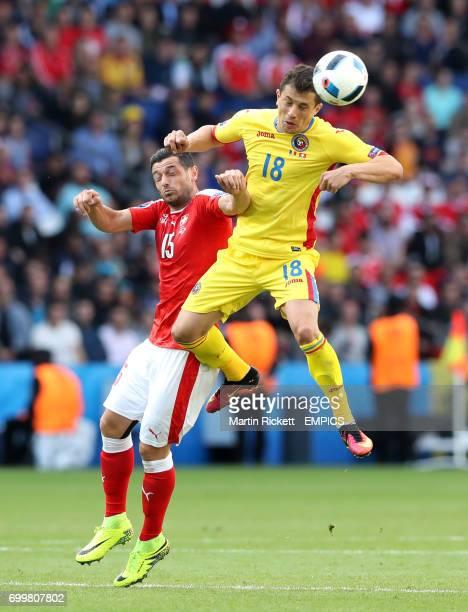 Switzerland's Blerim Dzemaili and Romania's Andrei Prepelita battle for the ball in the air