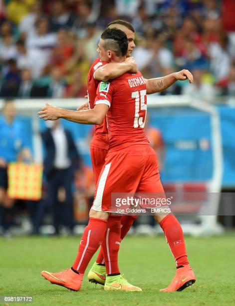 Switzerland's Blerim Dzemaili celebrates with teammate Switzerland's Granit Xhaka after scoring their first goal