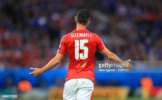 Switzerland's Blerim Dzemaili with a ripped shirt