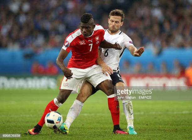 Switzerland's Breel Embolo and France's Yohan Cabaye battle for the ball
